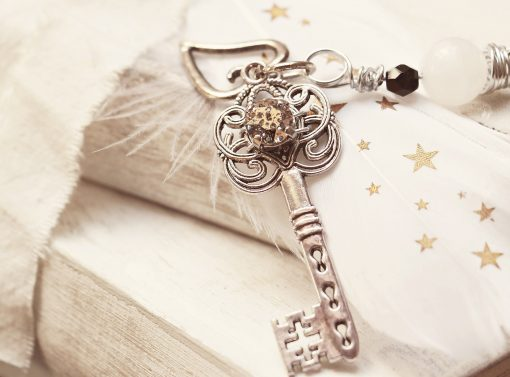 An ornate key charm.